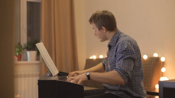 Thumbnail for Young Man Playing The Piano