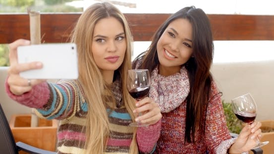 Thumbnail for Two Girls Taking Selfie While Holding Wine