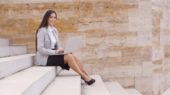 Thumbnail for Low Angle View Of Woman Using Laptop Outdoors