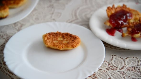 Thumbnail for Housewife Puts Cheese Pancakes On Plate