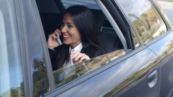 Thumbnail for Laughing Young Executive On Phone In Car