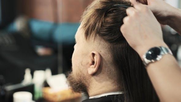 Thumbnail for Hairdresser Combing Hair