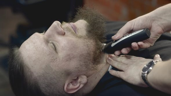 Thumbnail for Hairdresser Shaving Neck To a Hipster