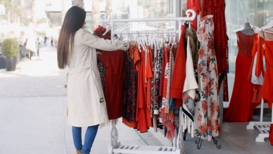 Thumbnail for Young Woman Looking For a Colorful Red Dress