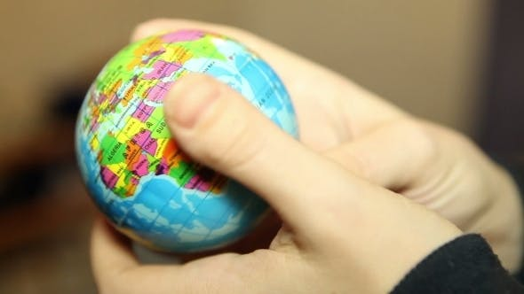 Thumbnail for Small Globe In The Hands Of Women