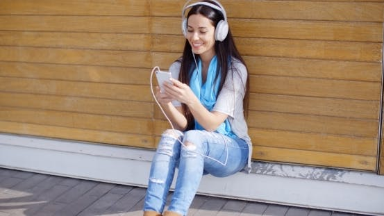Thumbnail for Attractive Young Woman Listening To Her Music