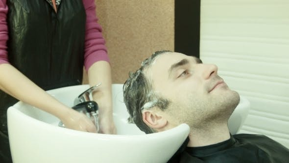 Thumbnail for Man In Beauty Salon Washes Head