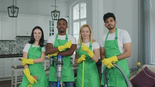 Mixed Race Staff in Special Uniform from Cleaning Service Looking at Camera
