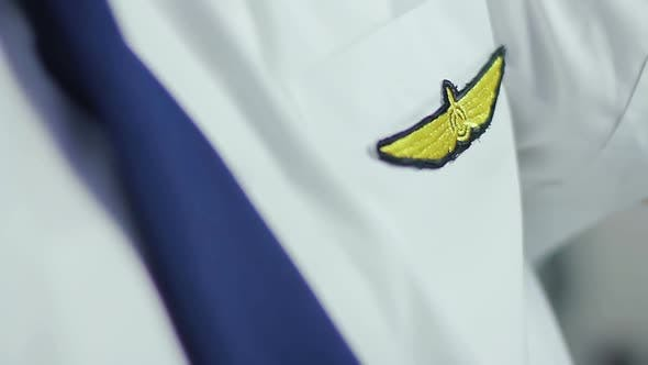 Pilot Insignia on Uniform, Closeup. Exciting Profession, Well Paid Job