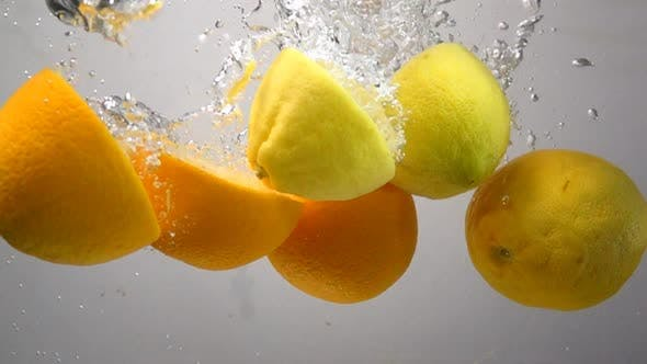 Thumbnail for Lemon and Orange Drops Into Water in Slow Motion