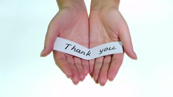 Cover Image for Note Thank You in Female Hands on a White Background