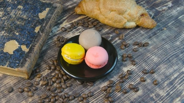 Thumbnail for Girl's Hand Puts a Cup Of Coffee And Taking Macaroon
