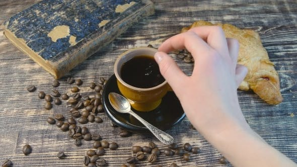 Thumbnail for Female Hand Stirs Sugar In Coffee