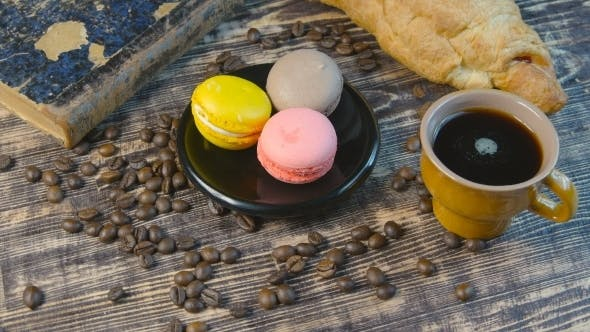 Thumbnail for Black Coffee And Multicolored Macarone On Vintage Background
