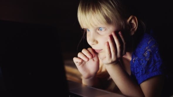 Thumbnail for Blue-eyed Girl 5-6 Years Old Lying On The Bed, Uses a Laptop