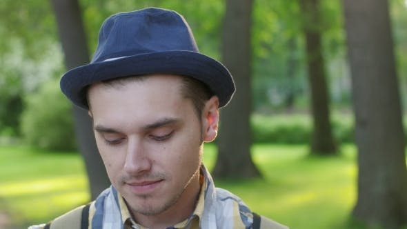 Portrait of Boy in Hat Showing Shyness, Timid Summer