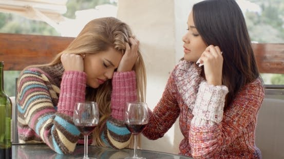 Cover Image for Girl Helping Her Depressed Friend At The Cafe