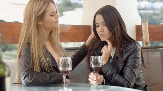 Cover Image for Blond Woman Comforting Friend Over Glass Of Wine