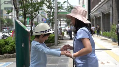 Asian Children Playing Together While Travel In Japan