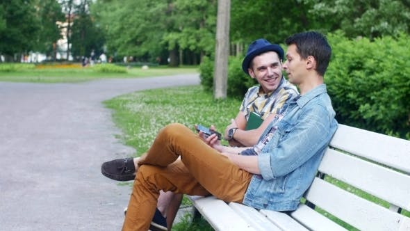 Two Men Sit on a Bench