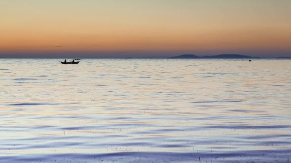 Thumbnail for Silhouetted Fisherman's Boats At Sunset Floating Calm Water.