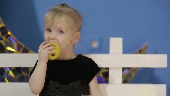 Thumbnail for Happy Girl Eating Apple