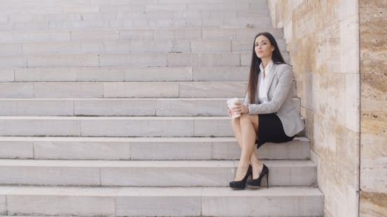 Thumbnail for Serious Woman Sitting On Stairs Outdoors