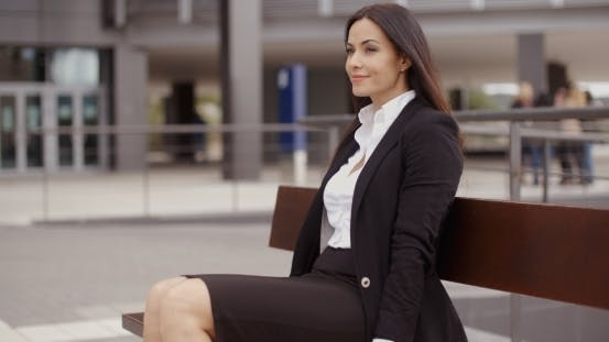 Thumbnail for Optimistic Business Woman Sitting Outdoors
