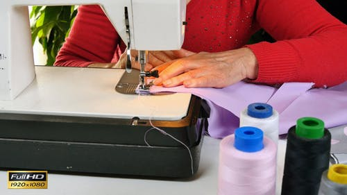 Tailor Sewing Clothes with her Sewing Machine