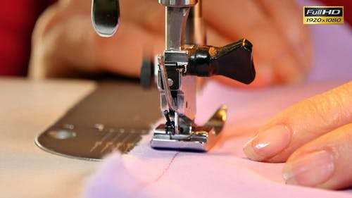 Seamstress Sews Clothes with her Sewing Machine