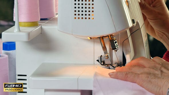 Thumbnail for Seamstress Sews Clothes with her Over Lock Machine