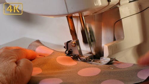 Seamstress Sews Clothes with her Over Lock Machine 4K