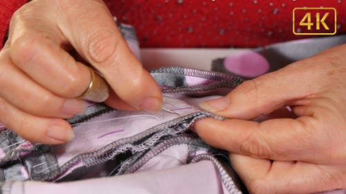 Seamstress Sewing with Sewing Needle and Thimble 4K