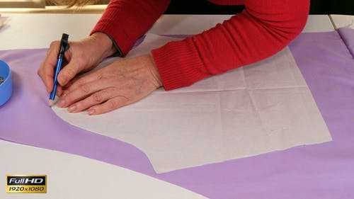 Seamstress Making Clothes Pattern