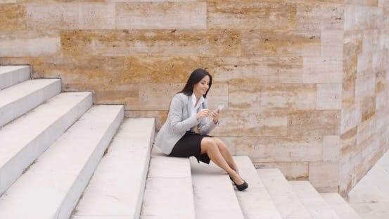 Thumbnail for Pretty Business Woman Sitting On Steps Using Phone