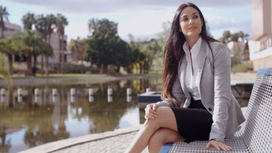 Thumbnail for Business Woman Sitting On Bench Looking Away