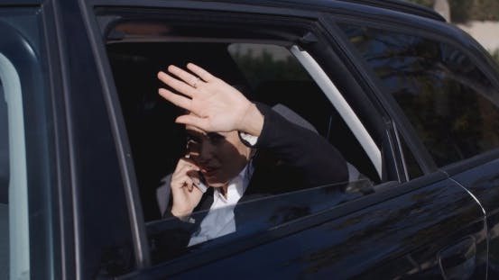 Thumbnail for Executive In Car Blocking View From Window