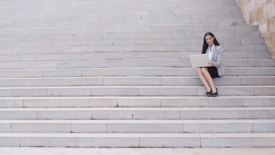 Thumbnail for Business Woman With Laptop On Stairs