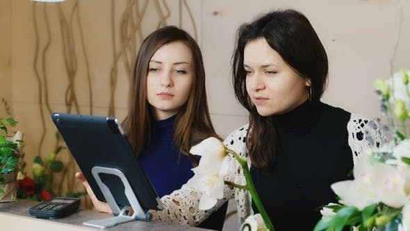 Thumbnail for Two Women Seller Working With The Tablet In Stores