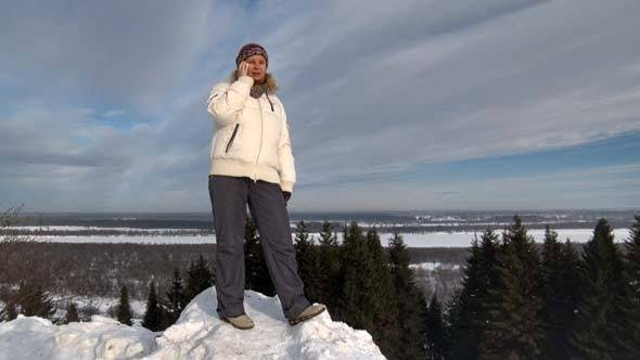 Thumbnail for Woman Speaks on the Phone in Winter