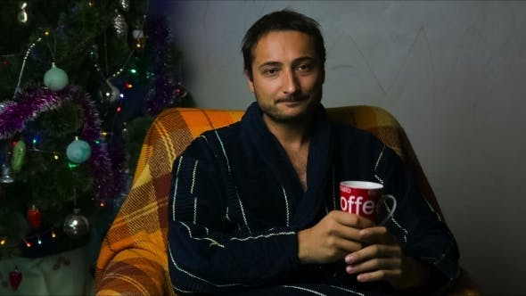 Thumbnail for A Man In A Bathrobe With A Cup