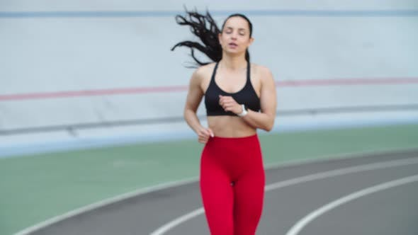Thumbnail for Woman Training in Sportswear on Athletics Track. Tired Fitness Girl Running