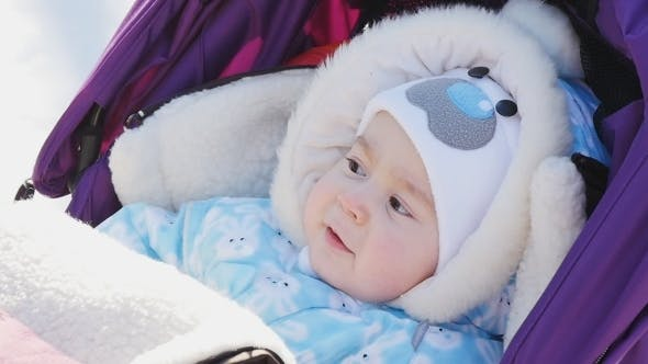 Portrait Of Cute Baby In Pram At Winter