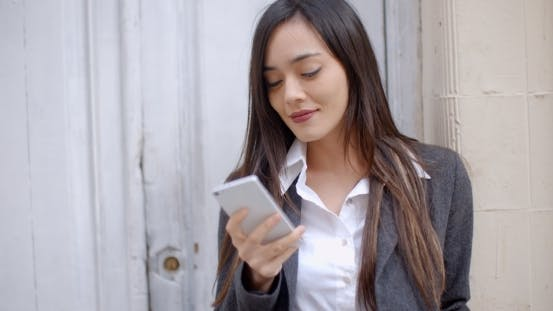 Thumbnail for Attractive Young Woman Sending a Text Message