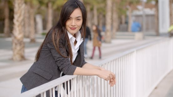 Thumbnail for Relaxed Thoughtful Young Woman Leaning On Railings
