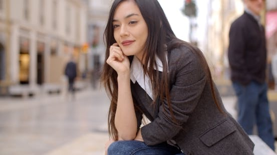 Thumbnail for Young Woman Sitting Waiting For Someone