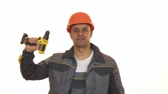 Thumbnail for Happy Mature Industry Worker in Hardhat Showing Thumbs Up Holding Drill