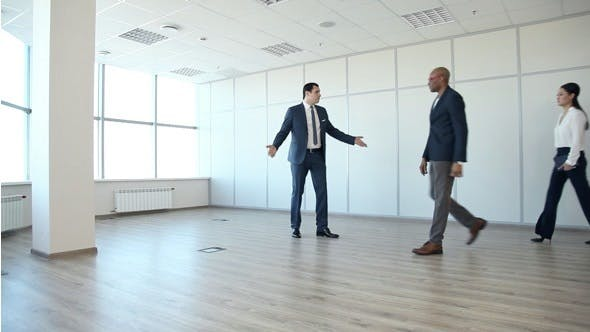 Thumbnail for Businessman Shows the Customer a New Office Space