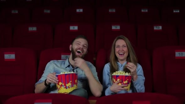 Thumbnail for Guy And a Girl Laughing In The Cinema