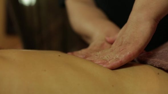 Thumbnail for Masseur Makes Massage With Oil For Girl